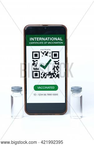 A Picture Of Smartphone With International Certificate Of Vaccination On It And 2 Doses Of Vaccine B