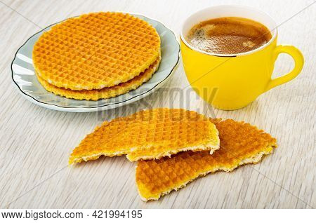 Round Wafers With Filling In Light-blue Saucer, Half Of Wafer, Yellow Cup With Coffee Espresso On Wo