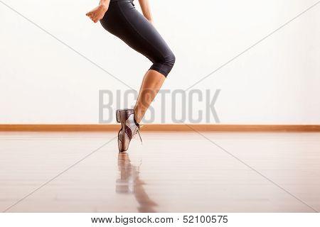 Tap dancing in a dance studio