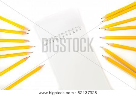 Notebook And Yellow Pencil