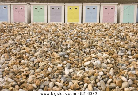 Interesting Juxtaposition Of Bech Huts To The Gravel On The Beach