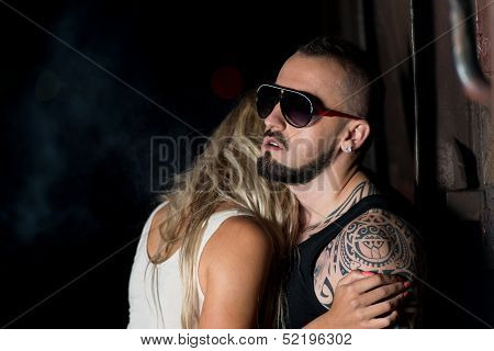 Macho Man Comforting His Girl