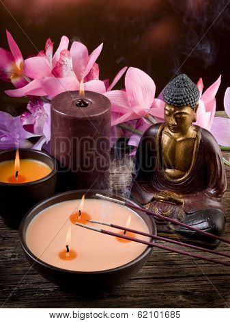 buddah witn candle and incense spa concept