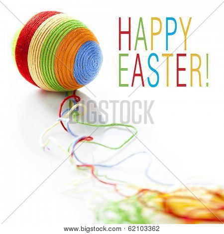 Colorful wool yarns unwrapped from easter egg. Space for text isolated on solid white background