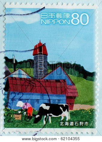 JAPAN - CIRCA 1990th: A stamp printed in Japan shows a dairy farm and cows on the meadow, circa 1990th