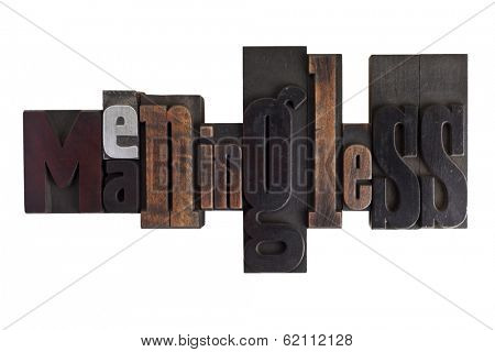 Word meaningless in vintage wooden letterpress type, scratched and stained, isolated on white background
