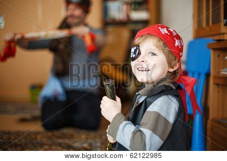 Little Preschool Boy Of 4 Years In Pirate Costume, Indoors.