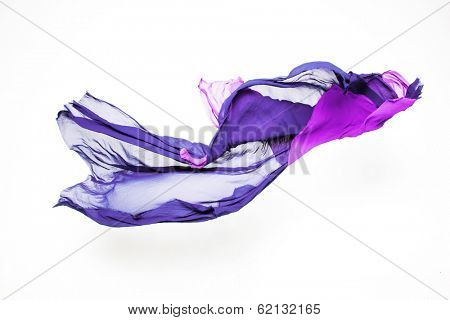 set of abstract pieces of purple fabric flying, high-speed studio shot