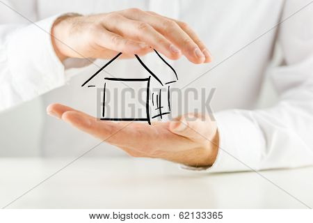 Man Protecting A House With His Hands
