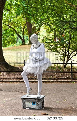 Woman Dressed As A Ballet Dancer In White Shows Pantomines To Collect Money For Amnesty Internationa