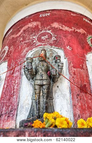 God of Sun statue with saffron flowers in Laxmi Narayan temple or Birla Mandir in New Delhi India poster