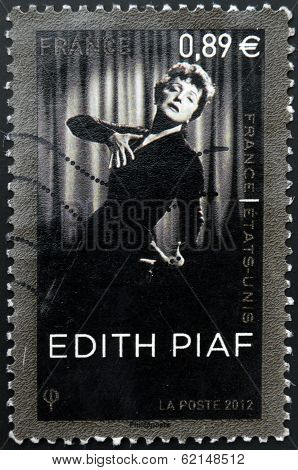 A stamp printed in France shows Edith Piaf