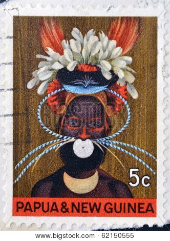 stamp printed in Papua New Guinea shows a man in a feathered headdress