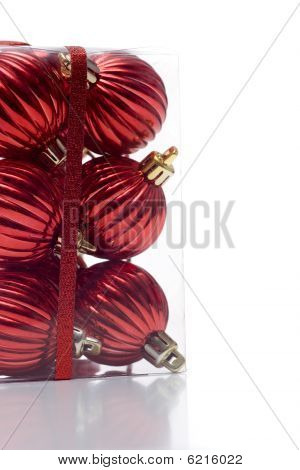 Bunch of red boxed ornaments with ribbon