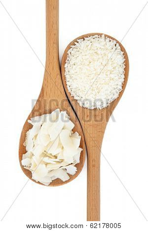 Dessicated and flaked coconut in wooden spoons over white background.