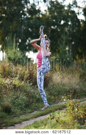 Athletic young woman working out in the country