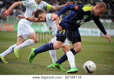 KAPOSVAR, HUNGARY - MARCH 16: Gergo Vaszicsku (blue 91) in action at a Hungarian Championship soccer game - Kaposvar (white) vs Puskas Akademia (blue) on March 16, 2014 in Kaposvar, Hungary.