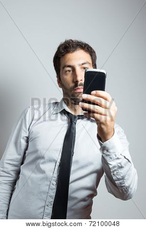 man in suit taking a selfie