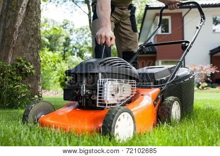 Turning On The Lawn Mower