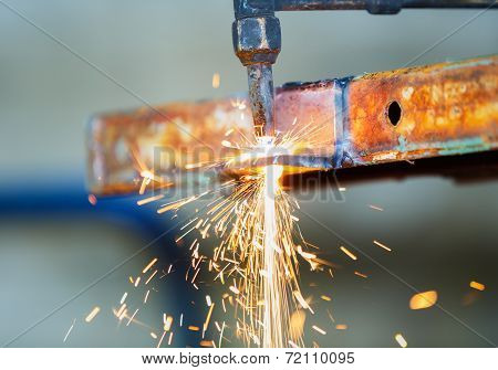 worker adjust acetylene torch to cutting construction poster