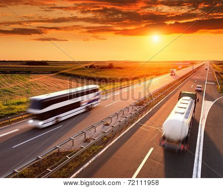Bus And Truck In Motion Blur On The Highway
