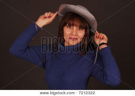 Pretty woman with cowboy hat