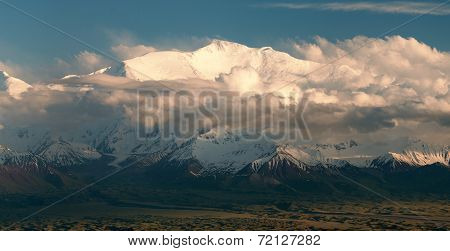 """Evening view of Lenin Peak from Alay range - Kyrgyz Pamir Mountains - Kyrgyzstan and Tajikistan border- Central Asia """"Roof of the World"""" poster"""