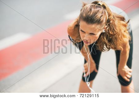 Portrait Of Tired Fitness Young Woman Outdoors In The City Catch
