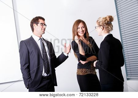 Business People Standing In The Office And Having Conversation