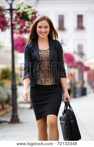 Happy Businesswoman Walking In The City