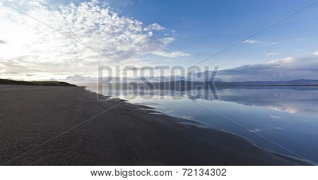 Black sand beach at the Icelandic River Olfusa