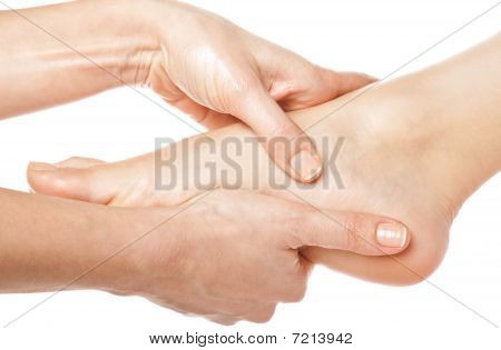 woman hands giving a foot massage on white background poster