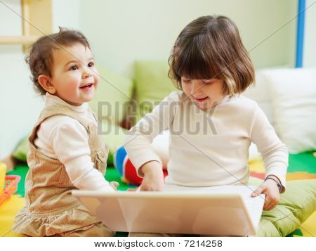 Two Little Girls Using Laptop Computer
