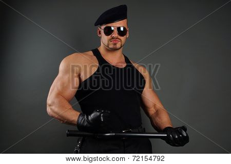 Muscular soldier with nightstick
