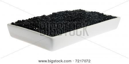 Black caviar in a white plate