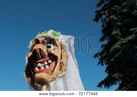 Carved wooden bride mask