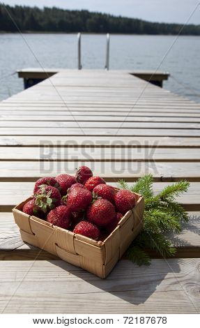 Strawberries In A Small Wooden Basket