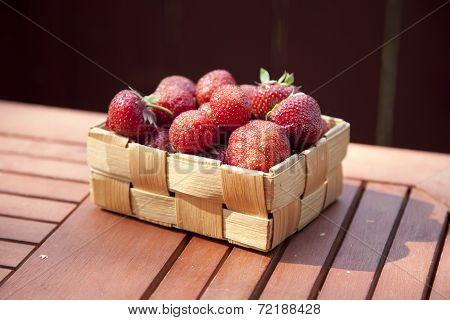 Fresh Strawberry In Basket On Wooden Table