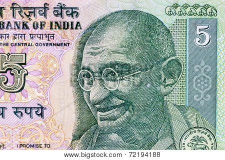 Closeup macro view of Mahatma Gandhi on an Indian currency note