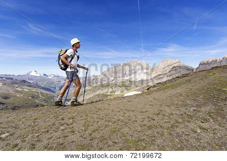 Man trekking in the Alps. Grand Paradiso National Park. Italy poster