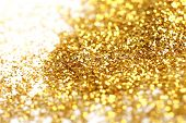 Closeup of golden glitter on white background poster