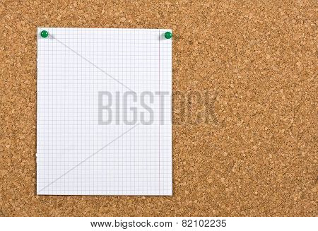 Empty Sheet On A Corkboard