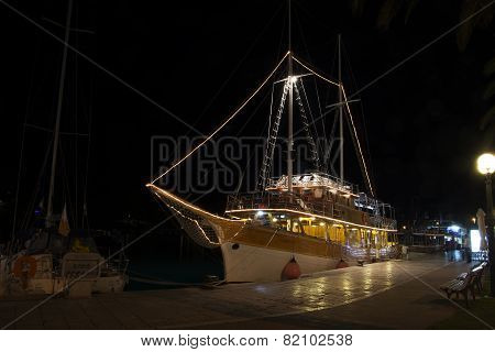 yacht in harbour at night