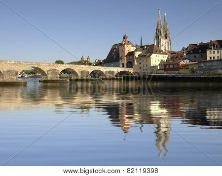 German city Regensburg with historical old stone bridge