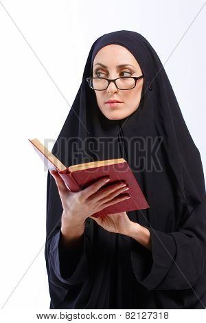 Beautiful Muslim woman holding a book