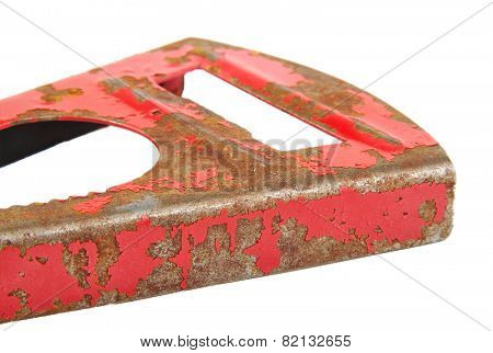 Red metal tool with rust isolated on white background