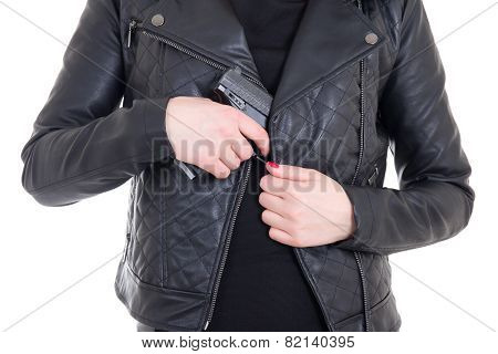Woman Hiding Gun In Leather Jacket Isolated On White