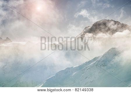 Winter Mountain Peaks At Sunset