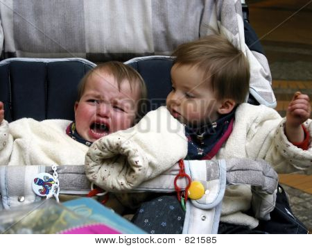 crying twins in the baby carriage