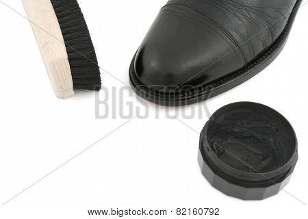 black leather shoe with brush and polish